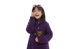 Little asian girl smartphone and holding passport Stock Image