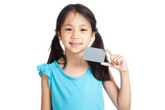 Little asian girl smile with a blank gray card Royalty Free Stock Images
