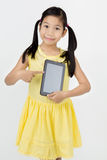 Little asian girl smiles with tablet computer Royalty Free Stock Image
