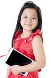 Little asian girl smiles with tablet computer Stock Photography