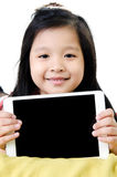 Little asian girl smiles with tablet computer Royalty Free Stock Photo