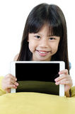 Little asian girl smiles with tablet computer Stock Photos