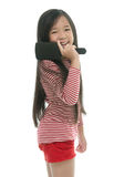 Little asian girl smiling and brushing hair Stock Image