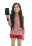 Little asian girl smiling and brushing hair Stock Photography