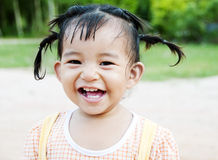 Little Asian Girl Smiling. A little Asian girl smiling in the garden Royalty Free Stock Photography