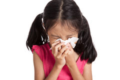 Little asian girl sneeze with napkin paper Stock Photos