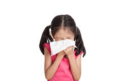 Little asian girl sneeze with napkin paper. Isolated on white background Royalty Free Stock Photography