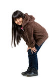 Little asian girl standing with hands on her knee Stock Photography