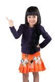 Little asian girl standing with index finger up Stock Photos
