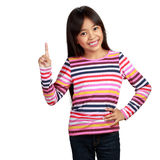 Little asian girl standing with index finger up. Isolated over white with clipping path stock photo