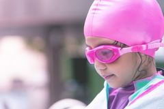 Little asian girl swimming with glasses stock images