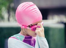 Little asian girl swimming with glasses royalty free stock images