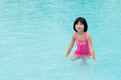 Little Asian girl in swimming pool Stock Photo