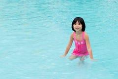 Little Asian girl in swimming pool Stock Photo