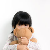 Little Asian girl with teddy bear Royalty Free Stock Photos