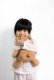Little Asian girl with teddy bear Royalty Free Stock Photo