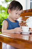 Little asian girl (thai) holding a cup Stock Image
