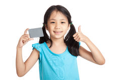 Little asian girl thumbs up with a blank gray card Stock Images