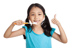 Little asian girl thumbs up with toothbrush Royalty Free Stock Photography