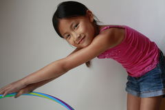 Little Asian girl with hula hoop Stock Photos