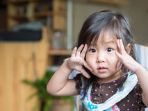 Little asian girl. Try to show big eyes action Stock Images