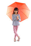 Little asian girl with umbrella Royalty Free Stock Photography