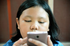 Little asian girl using smartphone Royalty Free Stock Image