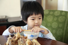 Little asian girl waiting for lunch. Stock Image