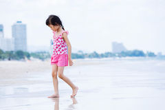 Little asian girl walk on the beach Stock Images