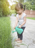 Little asian girl watering plants Royalty Free Stock Images