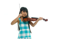 Little asian girl wearing blue dress playing violin Stock Images