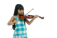 Little asian girl wearing blue dress playing violin Stock Image