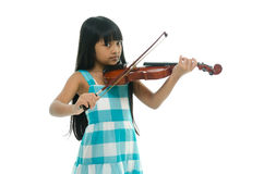 Little asian girl wearing blue dress playing violin Royalty Free Stock Photos