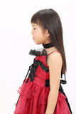 Little asian girl wearing dress Stock Photos