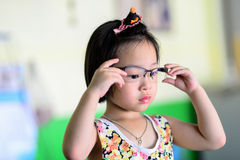 Little Asian Girl Wearing Glasses. Royalty Free Stock Photos