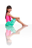 Little asian girl wearing swimsuit sitting on the floor Stock Images
