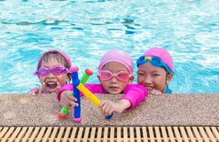 Little asian girls enjoy swimming Royalty Free Stock Photos