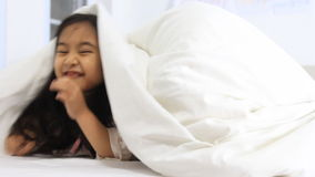 Little Asian girls playing hide and seek stock video footage