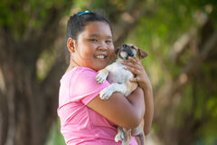 Little asian girls and puppy stock photo