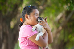 Little asian girls and puppy royalty free stock photo