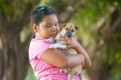 Little asian girls and puppy stock images