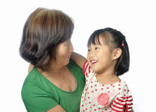Little asian granddaughter smile to her grandmother Royalty Free Stock Photos
