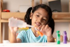 The little asian gril is testing color. On the table. Select focus shallow depth of field royalty free stock images