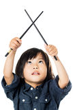 Little Asian kid with chopsticks looking up. Stock Photos