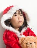 Little Asian little girl in santa costume waiting for Christmas Stock Photo