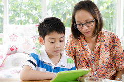 Little asian mother and son with tablet computer Royalty Free Stock Photo