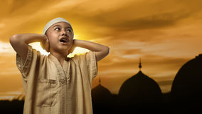 Little asian muslim boy with cap praying Royalty Free Stock Photos