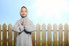 Little asian muslim child with hijab praying. At outdoor Royalty Free Stock Images
