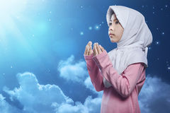 Little asian muslim kid in hijab pray Royalty Free Stock Photo