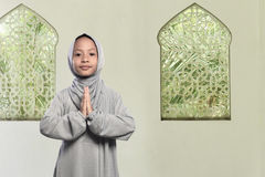 Little asian muslim kid with veil praying to go Stock Photos